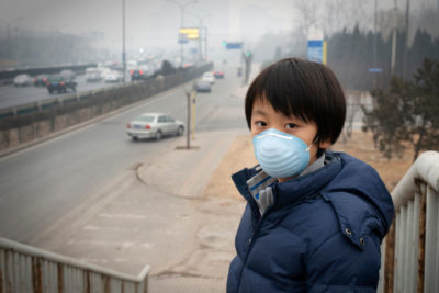 A young boy wears a mask to protect against air pollution in Beijing.