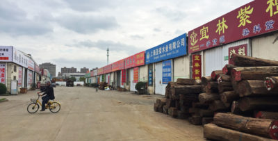 Rosewood piled outside a row of wholesale stores at Shanghai's Furen Market.