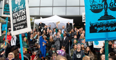 "The ""climate kids"" and their supporters rally on the steps of the U.S. courthouse in Eugene, Oregon on October 29 after their case was temporally stayed."