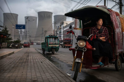 A vendor waits outside a coal-fired power plant in the Chinese city of Huainan. China's coal-burning statistics are widely seen as unreliable.