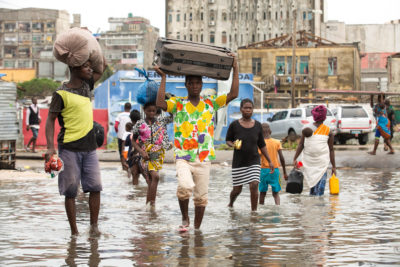 Residents of Mozambique flee floodwaters following Cyclone Idai in March 2019.