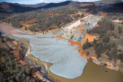 An aerial view of the damaged Oroville Dam spillway in California, and the debris field just below, in February 2017.