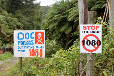 Signs opposing New Zealand's use of landscape-scale poisoning campaigns to eradicate non-native predators, such as rats and weasels.
