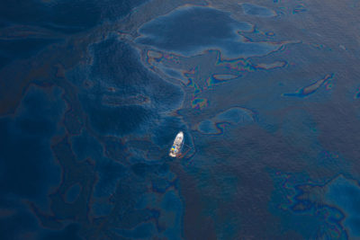 A ship moves through spilled oil in the Gulf of Mexico.