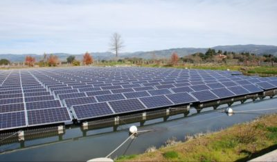 Floating solar panels on an irrigation pond at the Far Niente Winery in Oakville, California.