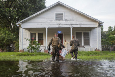 U.S. Marines deliver emergency supplies to a flooded house in Orange, Texas following Hurricane Harvey in September 2018.