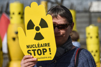 An activist in March 2017 demanding closure of the Fessenheim Nuclear Power Plant in France. Authorities announced in April that they will close the facility by 2020.