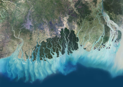 Satellite view of the Ganges-Brahmaputra Delta. Hydroelectric dams and sand mining have significantly reduced sediment flow into the delta.