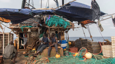 Crew members on a Korean fishing boat being arrested by Sierra Leone fishery inspectors in 2017 after illegal fishing gear was found onboard.