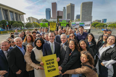 Los Angeles Mayor Eric Garcetti, center, announced this week that the city will phase out three natural gas power plants and replace them with renewables.