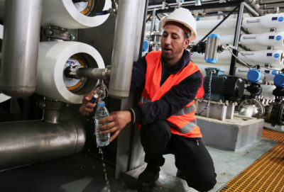 A worker at the opening of a desalination plant in Deir el-Balah in central Gaza in 2017.