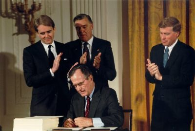 President George H.W. Bush signing the Clean Air Act Amendments in 1990.