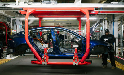 A Tesla Model 3 electric car being built in Fremont, California in 2018.