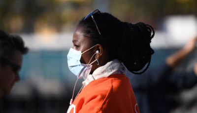 A woman watches the arrival of a U.S. Navy hospital ship in Los Angeles amid the coronavirus crisis last week.