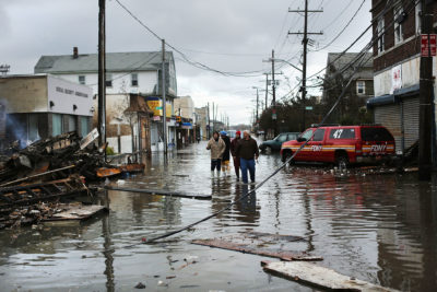 Surveying damage from Hurricane Sandy in October 2012 in the Rockaway section of Queens, New York.