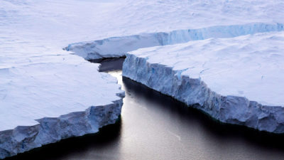 An iceberg (right) breaks off the Knox Coast in East Antarctica.