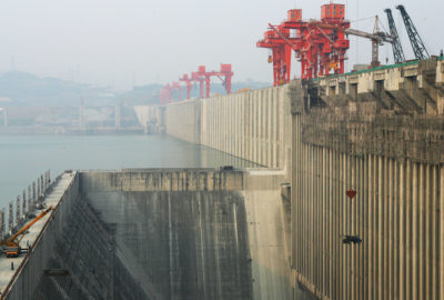 China's Three Gorges Dam, shown here under construction in 2006, is the world's largest. The corporation that built it now invests heavily in wind and solar energy.