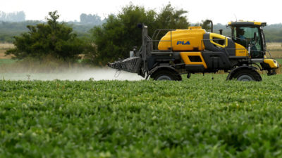 A farmer in Argentina, where glyphosate is used intensively, sprays a soybean field in Entre Rios province in February 2018.