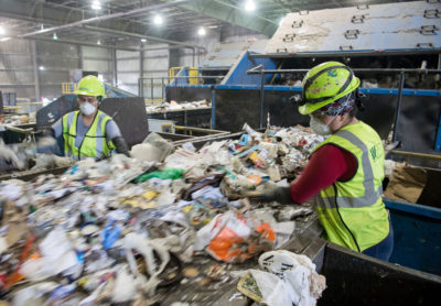 Workers sort recycling material at a waste management facility in Elkridge, Maryland.