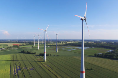 Wind turbines near Brueck, Germany in June 2016. Germany's nearly 30,000 wind turbines combined equal the power generation of about 10 nuclear reactors.