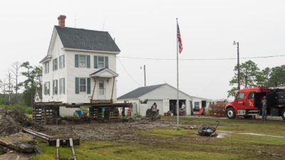 Mike Draper raised his house in southern Dorchester County seven feet to protect it from rising waters.