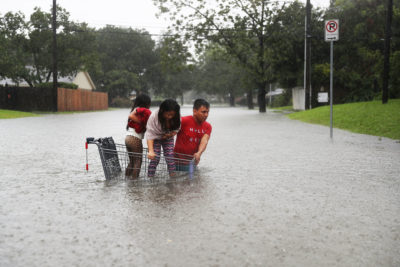 A family evacuates their home in Houston during Hurricane Harvey, which dumped 60 inches of rain in and around the city in August 2017.