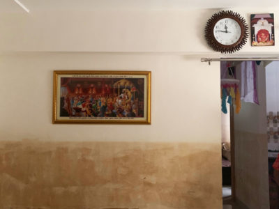 A water line in the middle of this wall shows how high floodwaters reached in one Badlapur home in July.