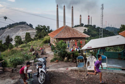 Children play near the Suralaya coal power plant in the city of Cilegon, Indonesia.