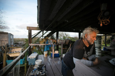 "Many islanders are distrustful of outsiders by nature. Edison Dardar, Jr., 69 says he has no intention of leaving Isle de Jean Charles. ""I don't want no house, me,"" he said in his heavy French accent in February 2018. ""I don't want to have nothing to do with them. I was born and raised on this island. That's my home."" He says he's not even listening to offers to relocate. ""Like I told them people that come, it go into that ear, pass to that one, straight shooting."""