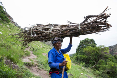 Alice Mbuthuma, whose daughter Nonhle is a leading opponent of the mining project, carries firewood after crossing the footbridge connecting Pondoland with Port Edward.
