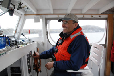 John Lipscomb, of the Riverkeeper conservation group, aboard the Ian Fletcher.