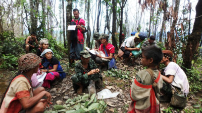Karen community members documenting ancestral land boundaries within the park.