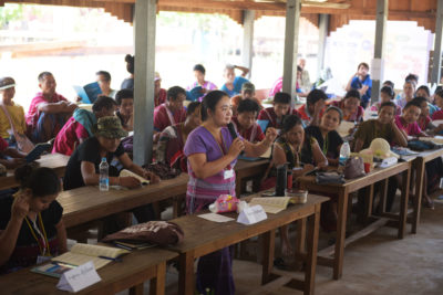 Naw Knyaw Paw, of the Salween Peace Park Governing Committee, explains the park's founding charter during a park-wide general assembly meeting.