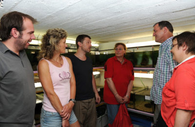 Michael Koeck [center left] gives a tour of the 90 tanks he manages in the basement of the Haus des Meeres aquarium in Vienna.