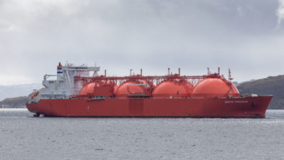 A tanker ship designed specifically to transport liquefied natural gas.