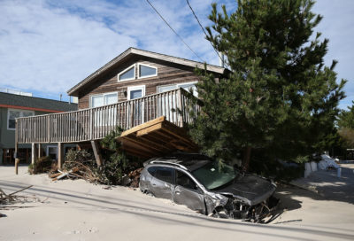 A house and car on Long Beach Island damaged in 2012 by Hurricane Sandy.