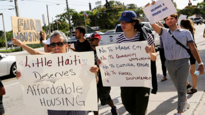 Demonstrators protest a proposed development project in Miami's Little Haiti neighborhood in 2019, arguing it will displace longtime residents.