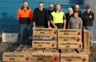 Volunteers for New Zealand's Predator Free by 2050 campaign in front of predator traps, which are available for the public to borrow.