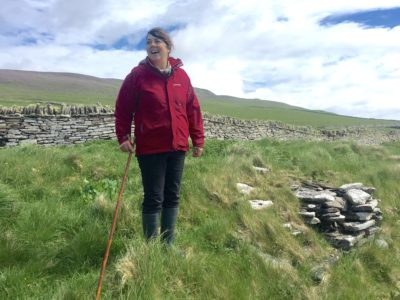 Archeologist Julie Gibson on Rousay Island, which has archeological finds dating back more than 5,500 years.