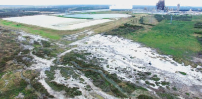 The Peelers contend that water from coal ash storage ponds frequently overflows onto the their ranchland, killing vegetation.