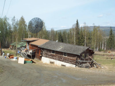A private house north of Fairbanks, Alaska unevenly sinking into thawing permafrost.