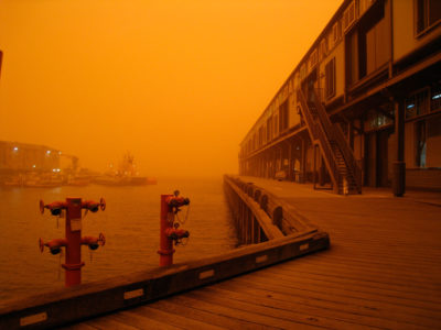 A massive dust storm in Australia in 2009, known as the Red Dawn, as seen from the Sydney waterfront.