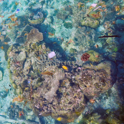 An aerial view of plastic floating over coral in Myanmar.