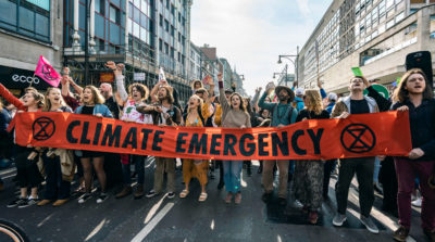 Climate activists block traffic in London's Oxford Circus on April 19, part of a string of protests organized by Extinction Rebellion.