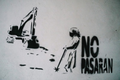 On the walls of COPINH's training center in La Esperanza, graffiti calls for opposition to the Agua Zarca dam project.