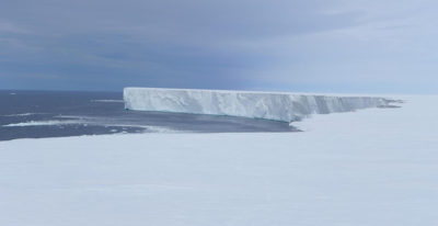 An ice-free area of ocean, also known as a polynya, in front of the Ross Ice Shelf in Antarctica.