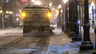 A snow plow truck lays down salt during a winter storm in Chicago in 2015.