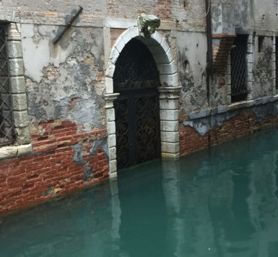 Frequent saltwater flooding is damaging Venice's structures, such as this building where plaster has eroded.