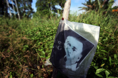 A photo memorializing Bill Kayong by the road where he was killed.