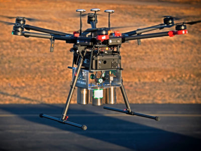 A drone equipped with laser-spectrometer sensors and air sampling canisters, developed by Scientific Aviation.
